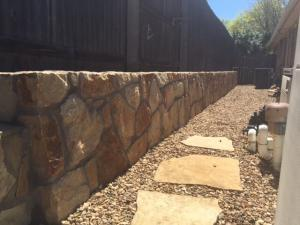 Rock wall and landscape in Bedford Texas