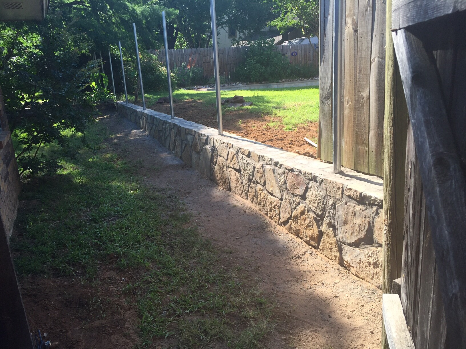 retaining wall fence jcl landscaping